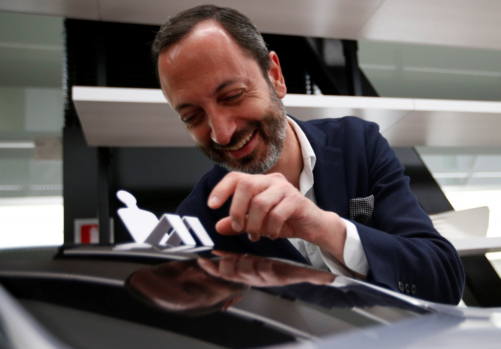 Infiniti, Nissan Motor's premium brand, Executive Design Director Habib smiles behind the brand's car model at its Global Design Center in Atsugi,