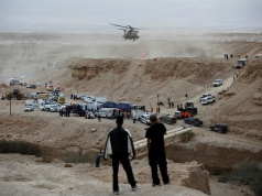 Israeli rescue services personnel operate near the site where a group of Israeli youths was swept away by a flash flood, near the Zafit river bed, south to the Dead Sea