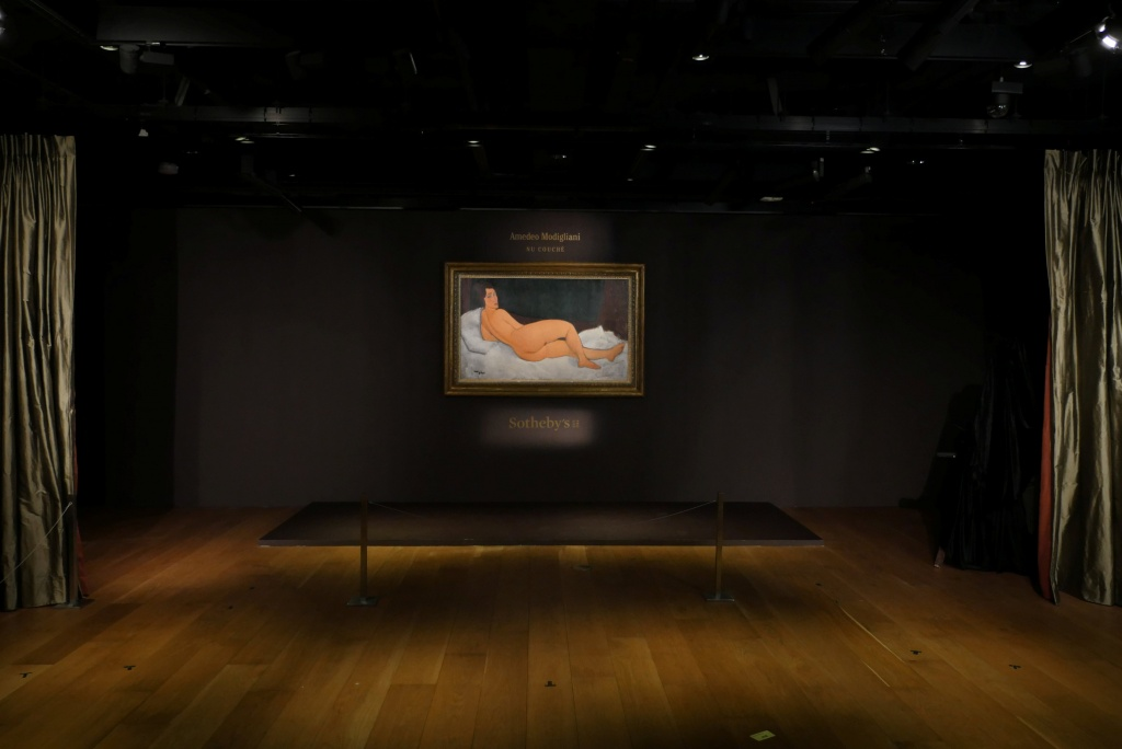 "Amedeo Modigliani's ""Nu couche"", expected to fetch over $150 million (USD) in the New York auction in May, is seen during a preview in Hong Kong"