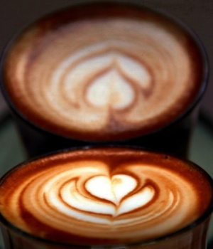 A photo illustration shows a coffee reflected in a coffee machine after it was made for a customer at a Sydney cafe in Australia