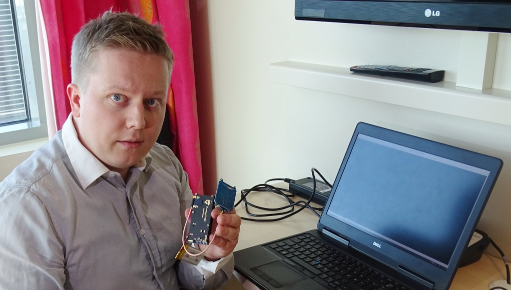 F-Secure researcher Hirvonen shows a device that is able to create a master key out of a single hotel key card in Helsinki