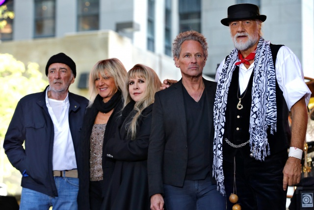 Members of the rock band Fleetwood Mac stand together on stage after performing a concert on NBC's 'Today' show in New York City