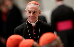 French Cardinal Tauran arrives to attend a prayer at Saint Peter's Basilica in the Vatican