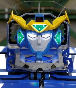 "New transforming robot called ""J-deite RIDE"" that transforms itself into a passenger vehicle, developed by Brave Robotics Inc, Asratec Corp and Sansei Technologies Inc, is unveiled at a factory near Tokyo"