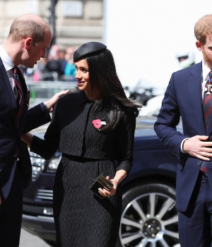 Britain's Prince William greets his brother Harry's fiancee Meghan Markle as they arrive for an ANZAC day service at Westminster Abbey in London