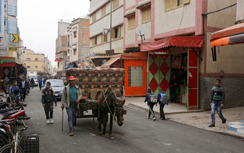 A man rides a horse cart in Ouled Moussa district, on the outskirts of Rabat,