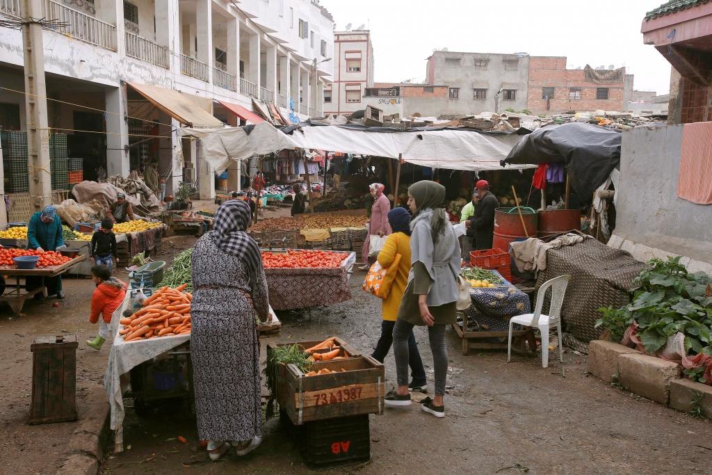 People buy fruits and vegetables at the market in Ouled Moussa district, on the outskirts of Rabat