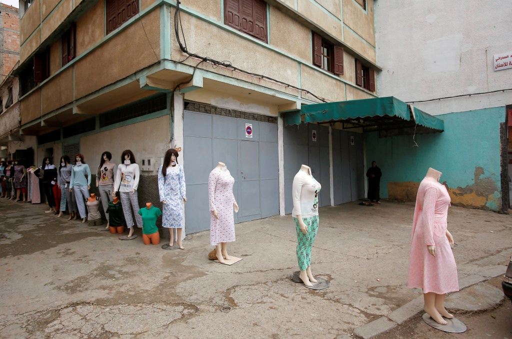 Mannequins displaying women's clothing for sale are lined in the street at the market in Ouled Moussa district, on the outskirts of Rabat
