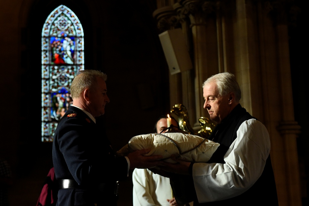 Assistant Commissioner of the Irish Police Pat Leahy returns the 800-year-old heart of the patron Saint of Dublin Laurence O'Toole to Archbishop Michael Jackson during a ceremony in Christ Church Cathedral after it was stolen six years ago, in Dublin
