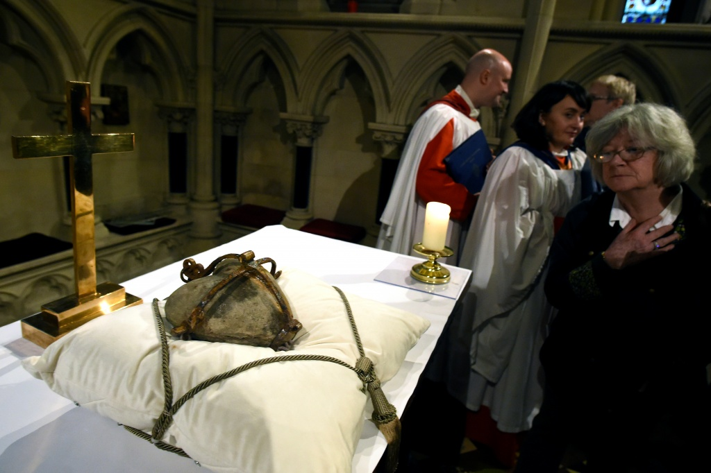 A woman looks at the 800-year-old heart of the patron Saint of Dublin Laurence O'Toole as it lies in repose returned to Christ Church Cathedral after it was stolen six years ago, in Dublin