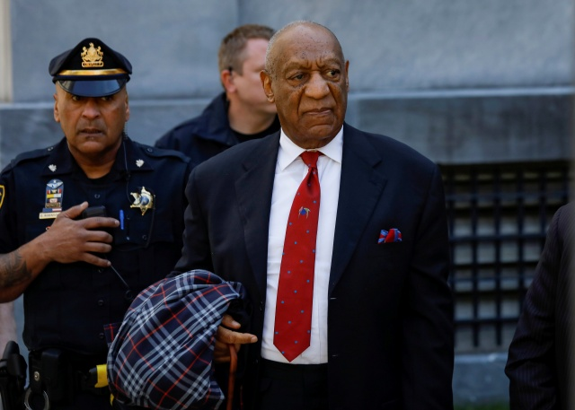 Actor and comedian Bill Cosby exits the Montgomery County Courthouse after a jury convicted him in a sexual assault retrial in Norristown, Pennsylvania