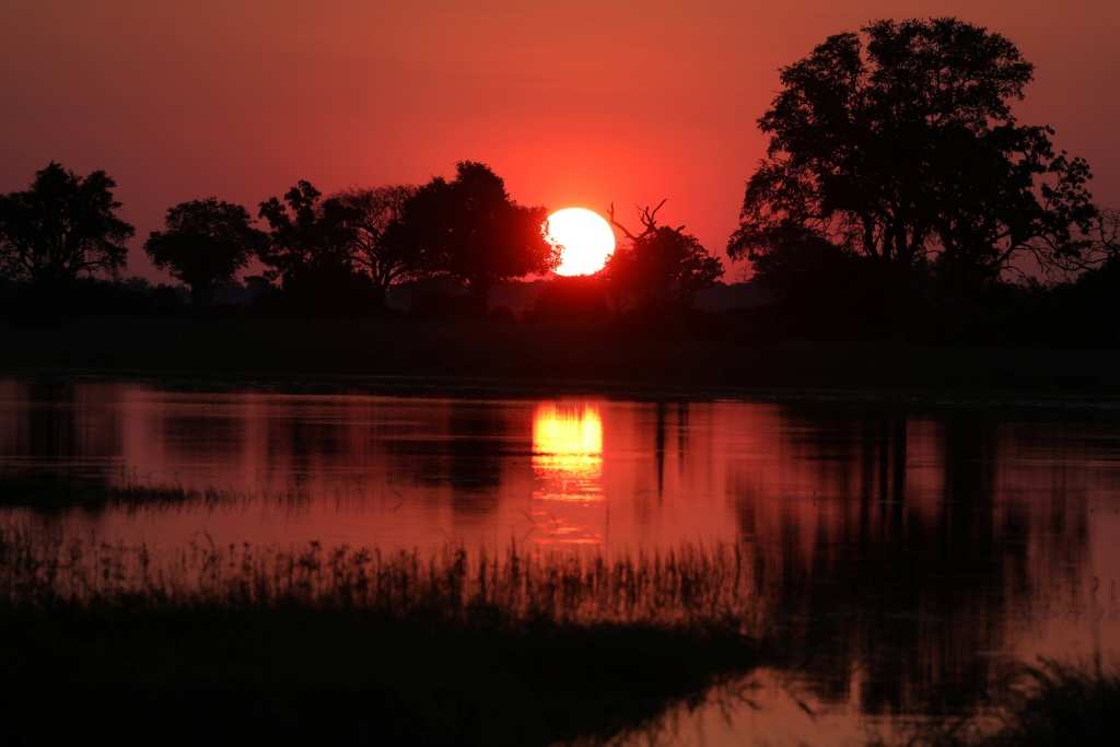 The sun sets over the Okavango Delta