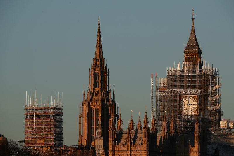The Big Ben clocktower and part of the Houses of Parliament are surrounded in scaffolding in London