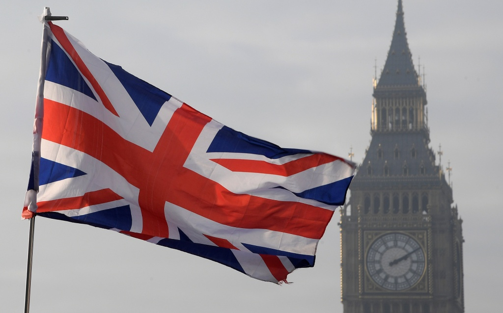 A Union flag flies in front of the Big Ben clock tower in London