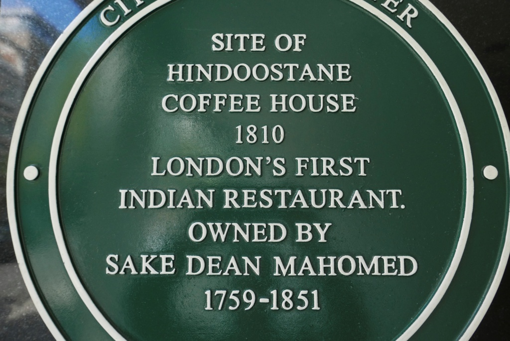 A plaque commemorates the site of London's first Indian restaurant, which is a question used in citizenship tests for migrants to Britain