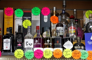 Bottles of alcoholic beverages are seen for sale in a shop in Glasgow
