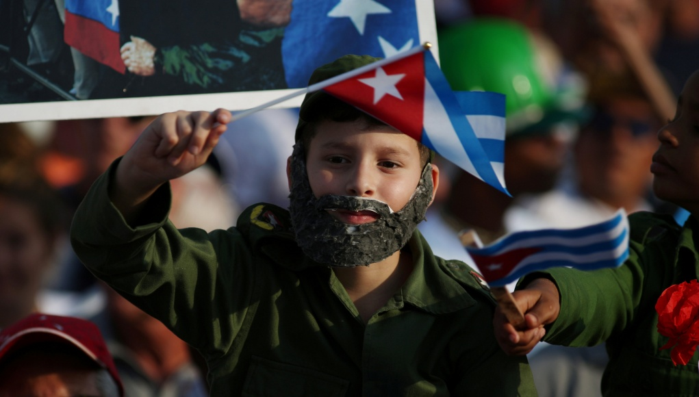 A boy wears a fake beard during the May Day rally in Havana