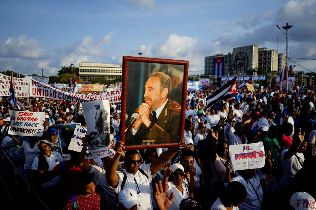 People carry images of Cuba's late President Fidel Castro during the May Day rally in Havana