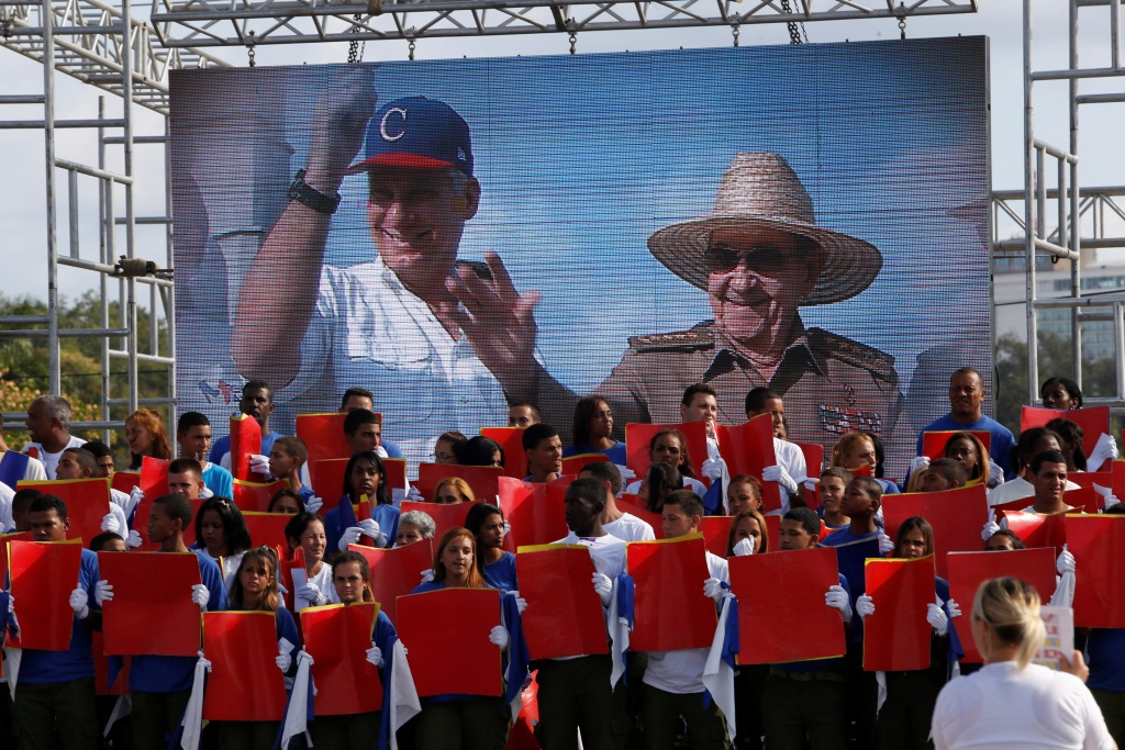 Cuba's First Secretary of the Communist Party and former President Raul Castro and Cuba's President Miguel Diaz-Canel are seen on the screen during the May Day rally in Havana