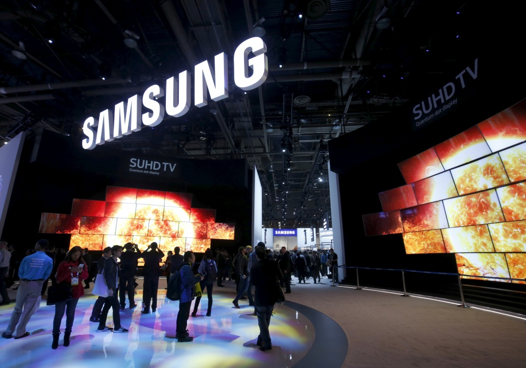 """Quantum Dot"" SUHD televisions are displayed at the Samsung Electronics booth during the 2016 CES trade show in Las Vegas"