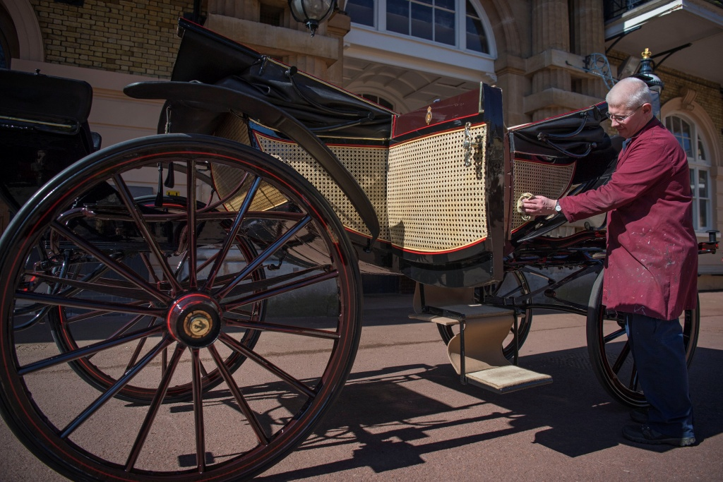 Martin Oates, Senior Carriage Restorer, polishes the Ascot Landau, which will be used in the case of dry weather at the wedding of Prince Harry and Meghan Markle, at the Royal Mews at Buckingham Palace