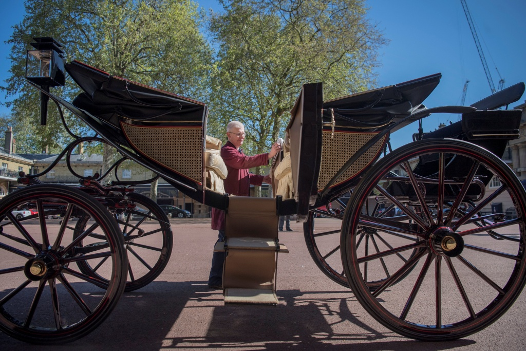 Martin Oates, Senior Carriage Restorer, polishes the Ascot Landau, which will be used in the case of dry weather at the wedding of Prince Harry and Meghan Markle, at the Royal Mews at Buckingham Palace, London.
