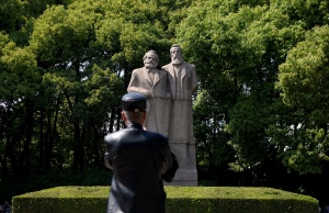 A man walks in front of the statue of German philosophers Karl Marx and Friedrich Engels at a park in Shanghai