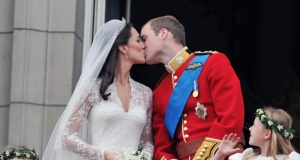 Britain's Prince William and his wife Catherine, Duchess of Cambridge kiss on the balcony of Buckingham Palace