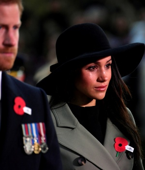 Britain's Prince Harry and his fiancee Meghan Markle attend the Dawn Service at Wellington Arch to commemorate Anzac Day in London, Britain