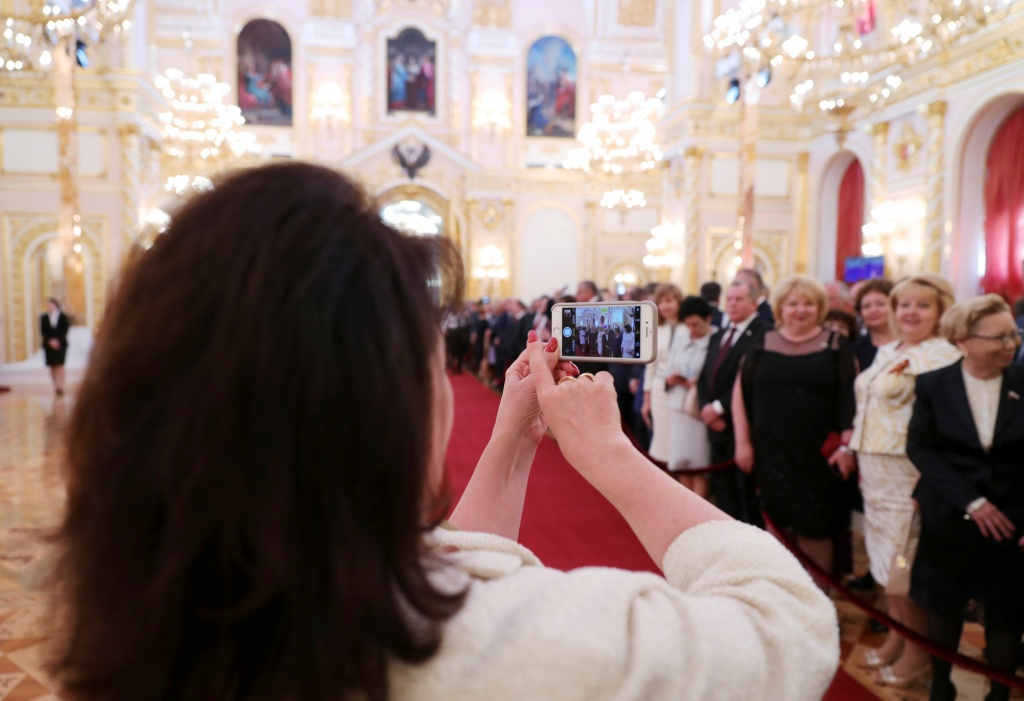 Guests gather before a ceremony to inaugurate Vladimir Putin as President of Russia at the Kremlin in Moscow