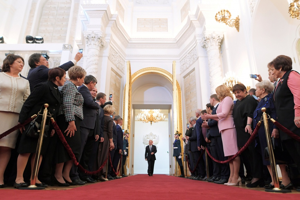 Guests attend a ceremony inaugurating Vladimir Putin as President of Russia at the Kremlin in Moscow