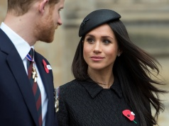 Britain's Prince Harry and his fiancee Meghan Markle attend a Service of Thanksgiving and Commemoration on ANZAC Day at Westminster Abbey in London