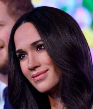 Waxwork models of Britain's Prince Harry and his fiancee Meghan Markle are seen on display at Madame Tussauds in London