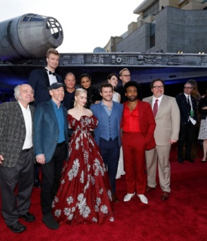"Director of the movie Howard poses with cast members Howard, Suotamo, Harrelson, Clarke, Newton, Ehrenreich, Waller-Bridge, Bettany, Glover and Favreau at the premiere for the movie ""Solo: A Star Wars Story"" in Los Angeles"