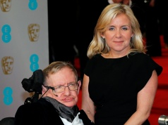 Theoretical physicist Stephen Hawking and his daughter Lucy arrive at the British Academy of Film and Arts (BAFTA) awards ceremony at the Royal Opera House in London