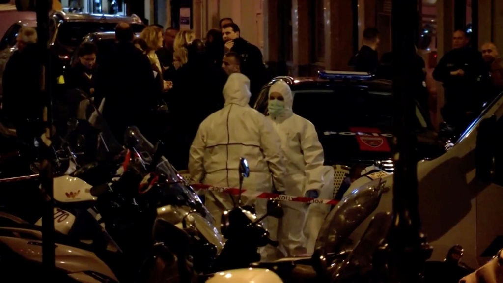 Personnel are seen at the scene of a knife attack in Paris