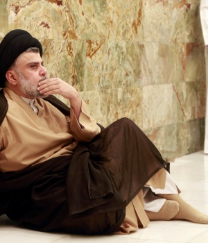 Iraqi Shi'ite cleric Moqtada al-Sadr visits his father's grave after parliamentary election results were announced, in Najaf