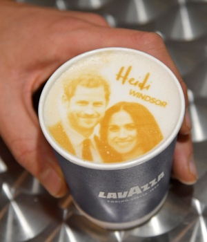 An image of Britain's Prince Harry and his fiancee Meghan Markle is seen on top of a cup of coffee being sold ahead of their forthcoming wedding in Windsor, Britain