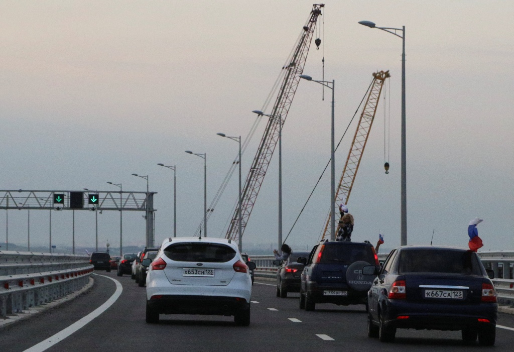 Cars drive along a bridge, which was constructed to connect the Russian mainland with the Crimean Peninsula across the Kerch Strait
