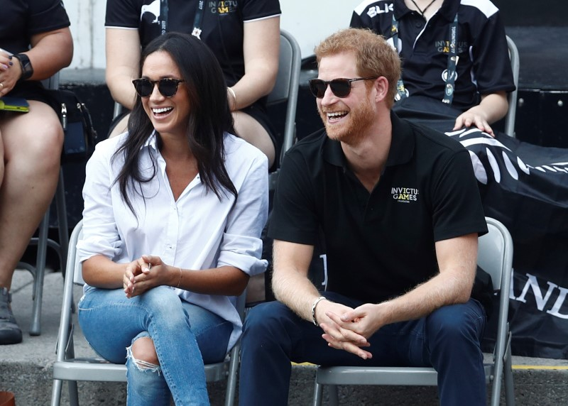 Britain's Prince Harry and his girlfriend actress Markle watch the wheelchair tennis event during the Invictus Games in Toronto
