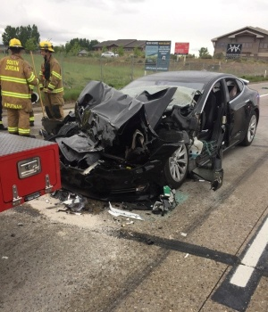 A Tesla Model S is seen after it hit the back of a mechanic truck in South Jordan