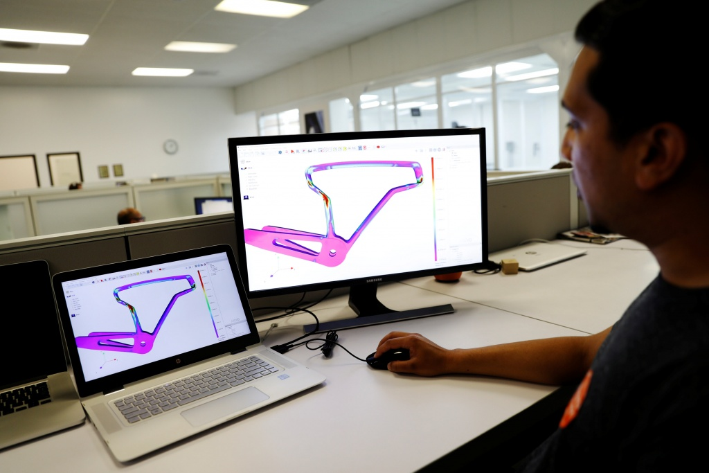 An engineer displays finite element analysis (FEA) of a 3D-printed carbon fiber bicycle frame at Arevo Labs in Santa Clara, California