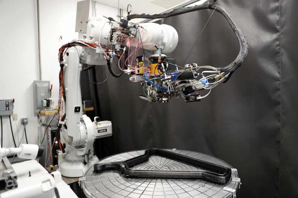 A 3D-printing robot is seen printing a carbon fiber bicycle frame at Arevo Labs in Santa Clara, California