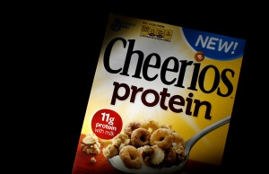 A box of Cheerios cereal, fortified with soy and pea protein, is seen in this photo illustration in Wilmette