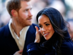 Britain's Prince Harry and his fiancee Meghan Markle arrive at an event in Nottingham