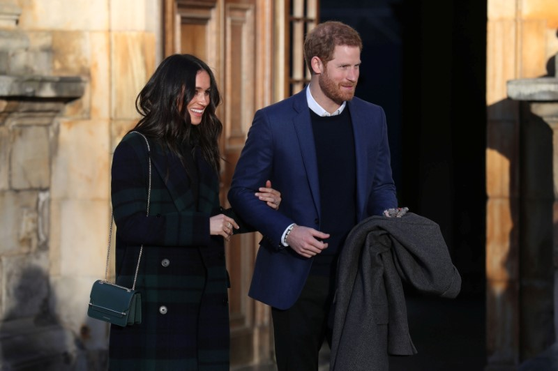 Britain's Prince Harry and his fiancee Meghan Markle attend a reception for young people at the Palace of Holyroodhouse in Edinburgh