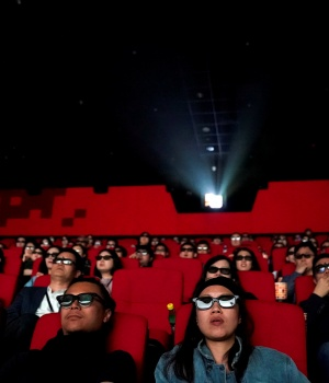 People watch a movie at a cinema in Wanda Group's Oriental Movie Metropolis ahead of its opening, in Qingdao