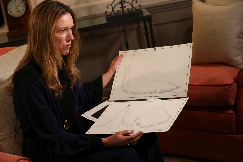 Clare Waight Keller, designer at Givenchy, holds sketches as she gives an interview the day after Meghan Markle walked down the aisle of St George's Chapel in Windsor and married Prince Harry wearing the dress that she created, in Kensington Palace, London