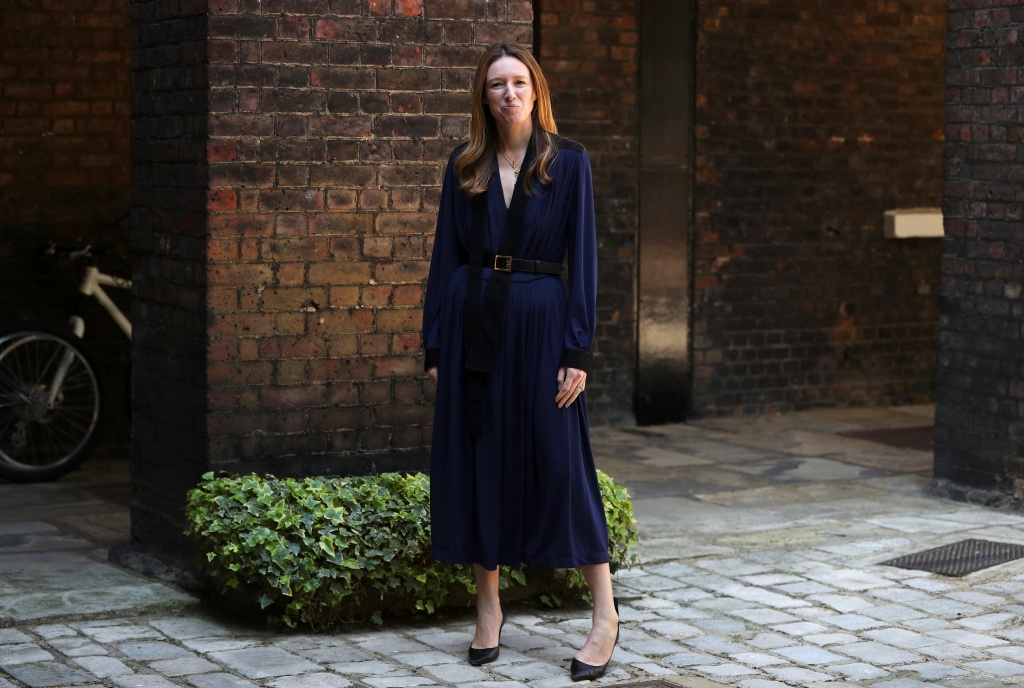 Clare Waight Keller, designer at Givenchy, poses for a portrait the day after Meghan Markle walked down the aisle of St George's Chapel in Windsor and married Prince Harry wearing the dress that she created, in Kensington Palace, London