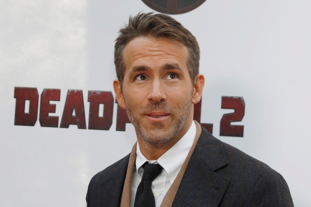 Actor Ryan Reynolds poses on the red carpet during the premiere of